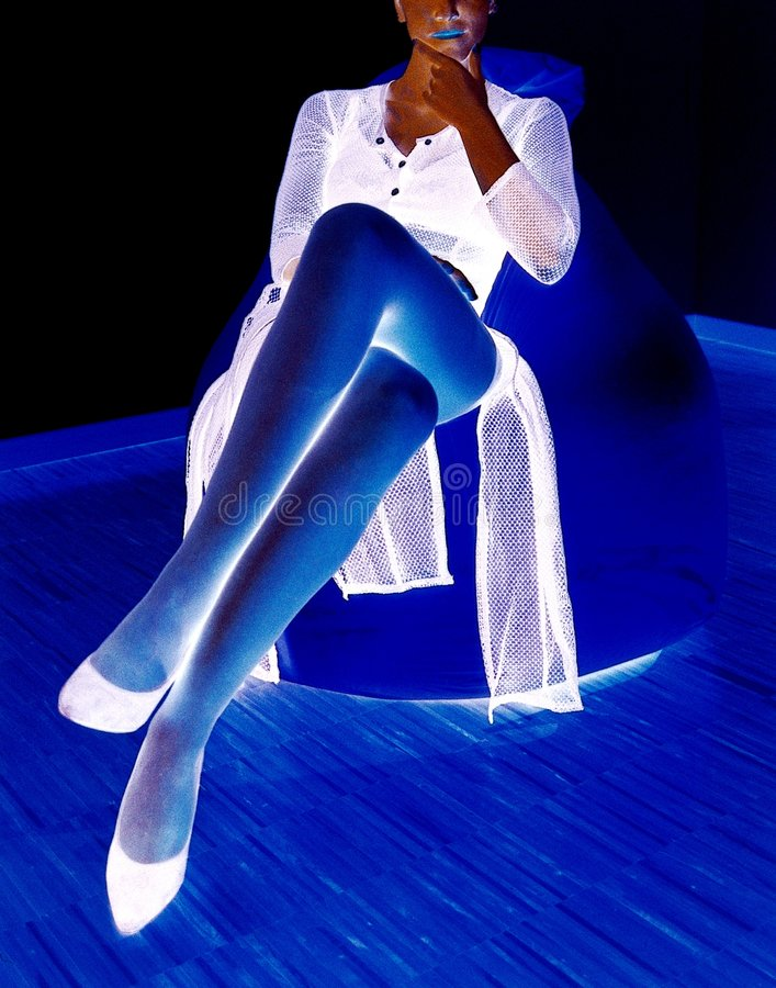 Lady legs. In negative colors stock photography