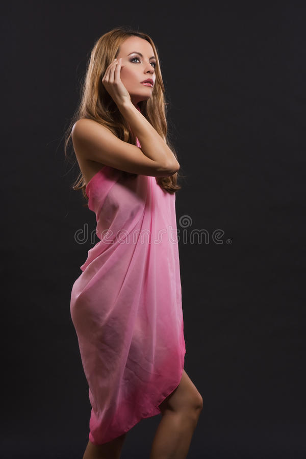 lady posing in a flimsy dress royalty free stock photography
