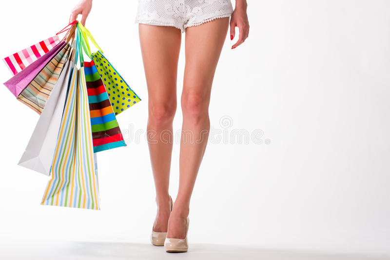 Lags. Shopaholic. Girl go shopping with shopping bags. lags. Shopaholic royalty free stock photo