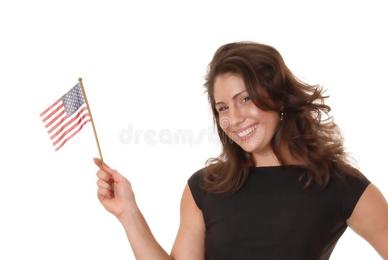 Latina with American Flag. Young beautiful and latina girl with an american flag royalty free stock images