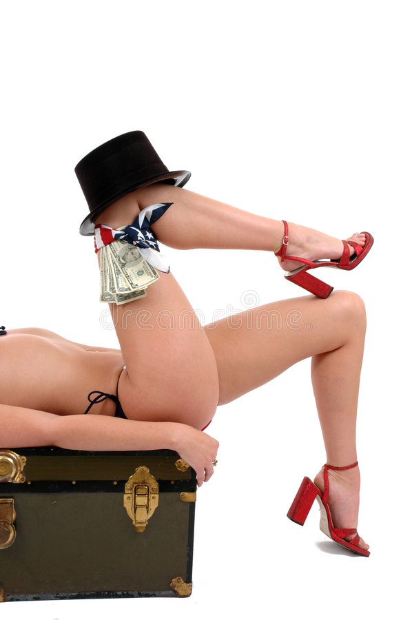 Legs. A pair of shapely legs with a top hat and money on the knee stock photo