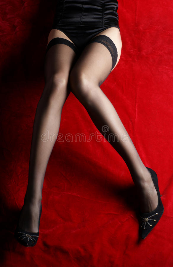 Download Legs In Erotic Black Stocking On Red Silk Stock Image - Image: 17757955