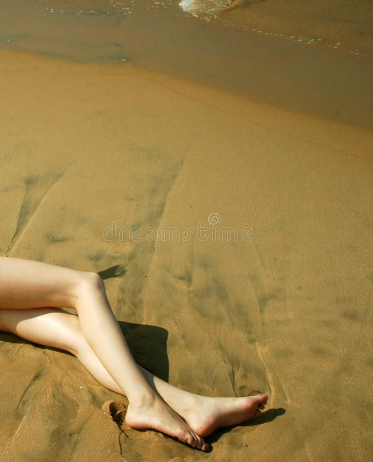 Legs On Sand Free Stock Images