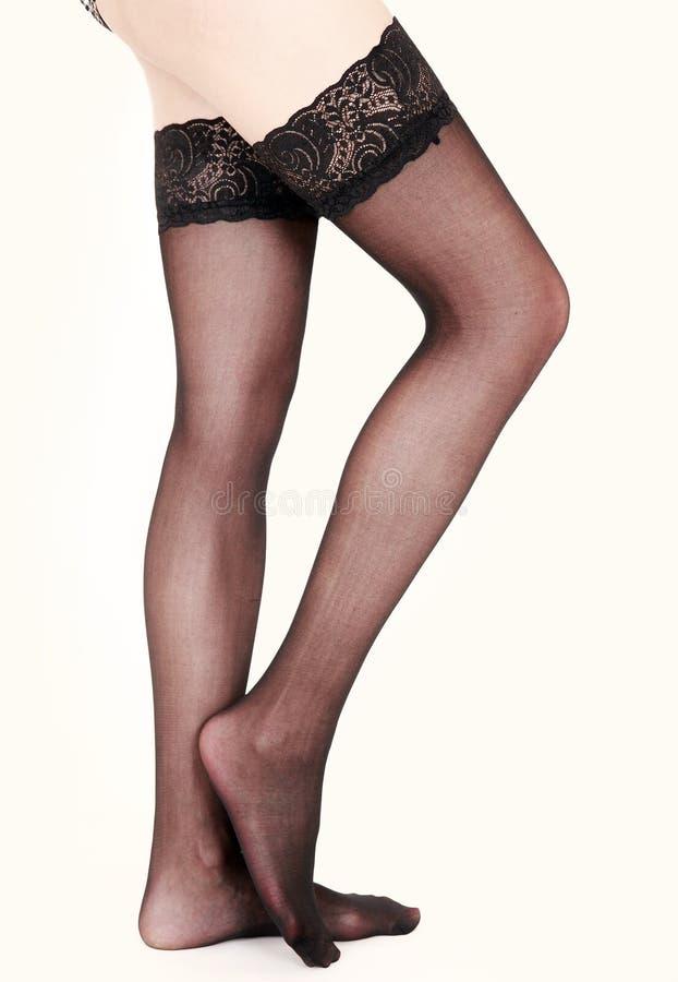 legs in stockings stock image