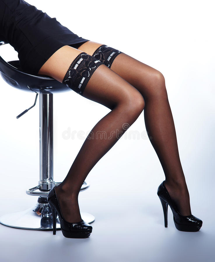 Legs Of A Young Woman In Black Stockings Royalty Free Stock Photography