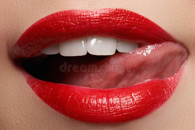 Lips. Beauty Red Lips. Beautiful make-up Closeup. Sensual Mouth. Lipstick and Lipgloss.  stock image