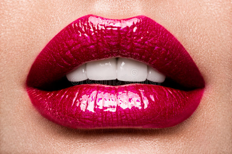 Lips. Beauty Red Lips Makeup Detail. Beautiful Make-up Closeup. Sensual Open Mouth. lipstick or Lipgloss royalty free stock photography