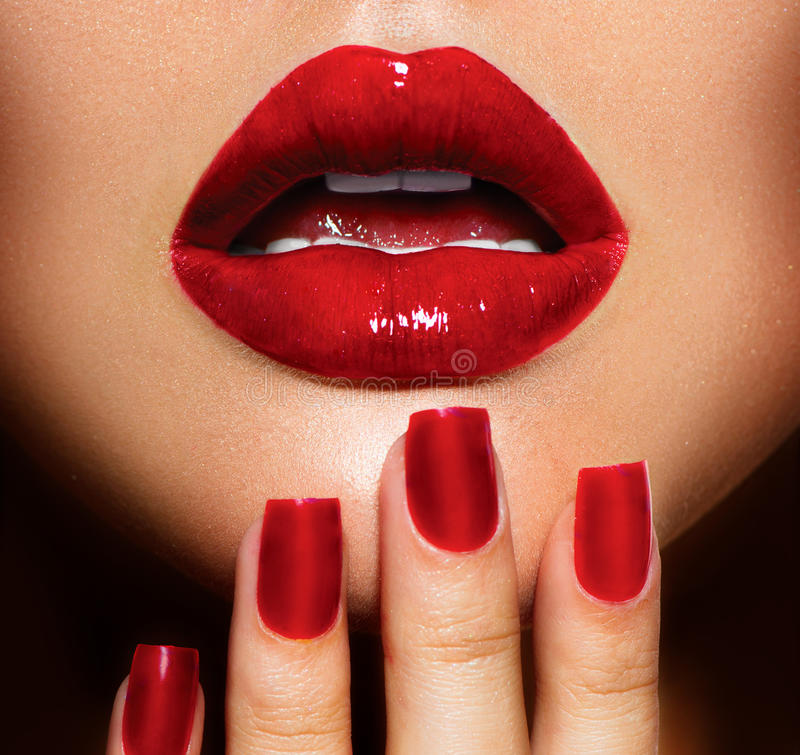 Lips and Nails closeup. Red Lips and Nails closeup. Manicure and Makeup royalty free stock image