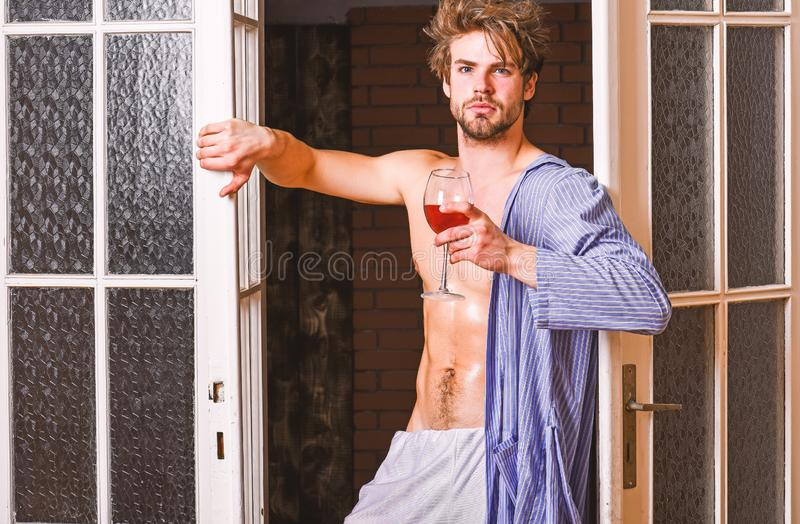 Sexy lover concept. Bachelor sexy body chest and belly. Sexy attractive macho tousled hair coming out through bedroom. Door. Guy shimmering sweaty skin wear stock photos