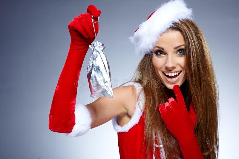 Sexy Mädchen mit Weihnachtsgeschenken stockfotografie