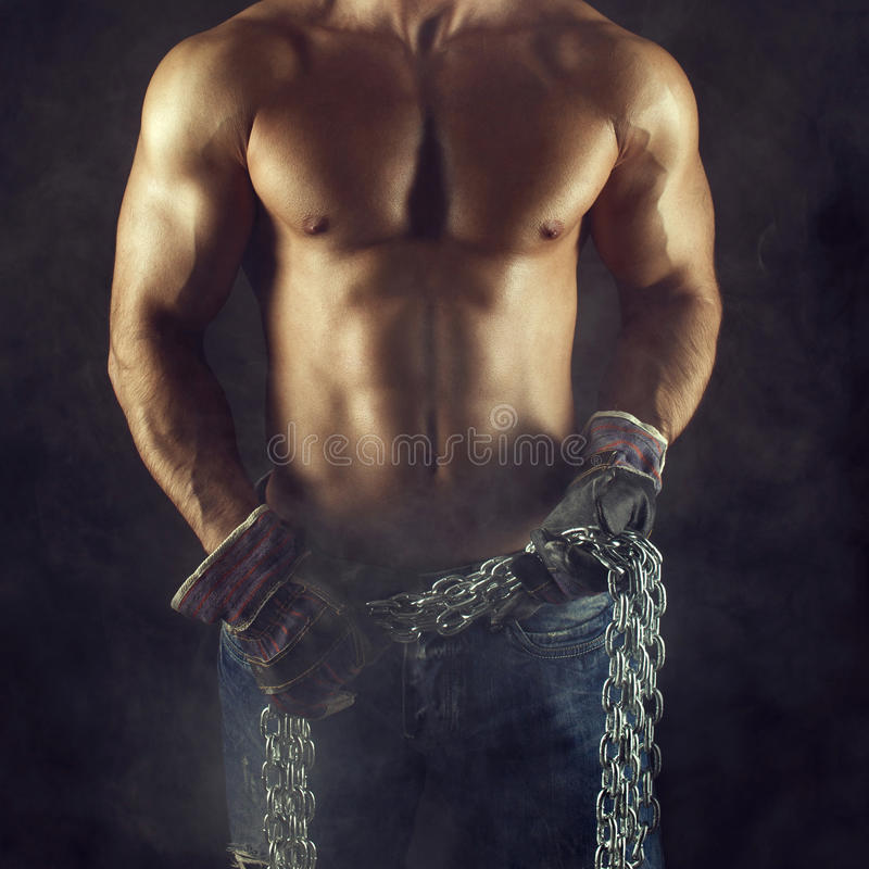 Macho man body with chain. Macho man body, worker holding chain in gloves royalty free stock images