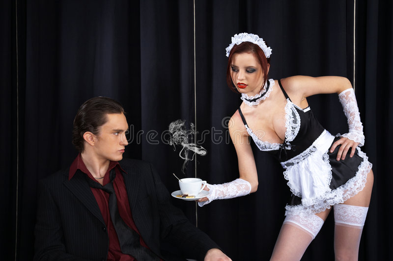 maid giving a cup of coffee royalty free stock images
