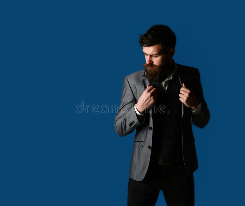 male, brutal macho, hipster. Handsome bearded businessman in classic suit. Male in suit, man in tuxedo, stylish man stock photo