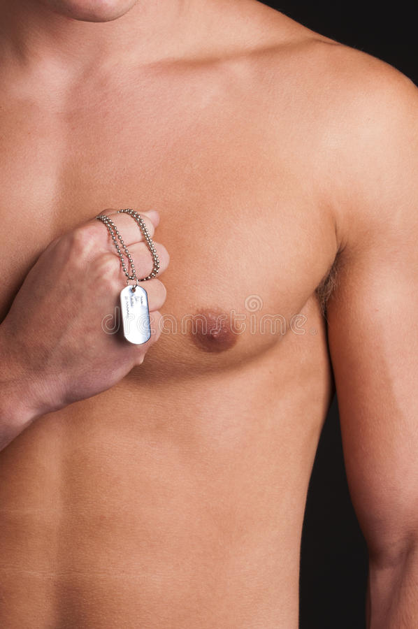 male model topless with a military identifica stock photo