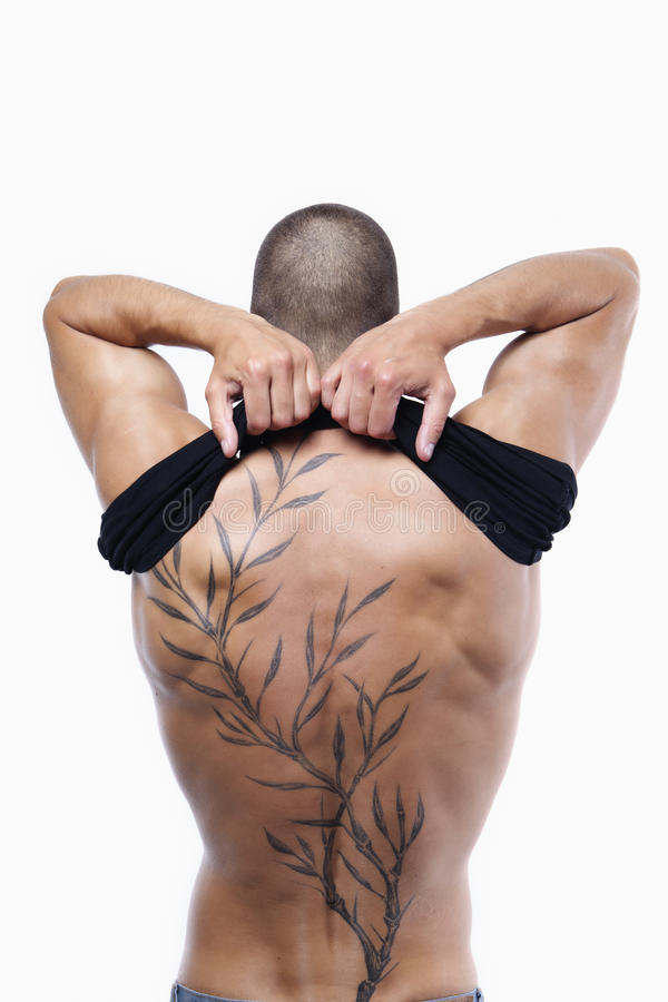 male's back with tattoo stock photo