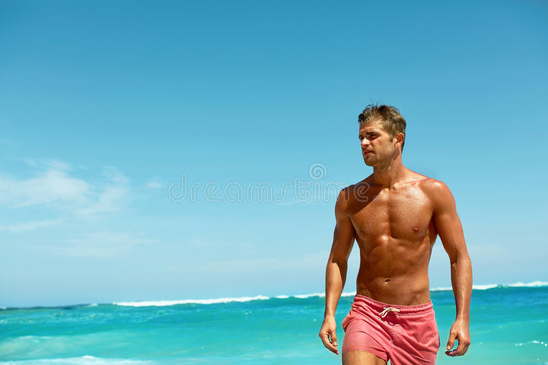 Man On Beach In Summer. Male Relaxing Near Sea stock images