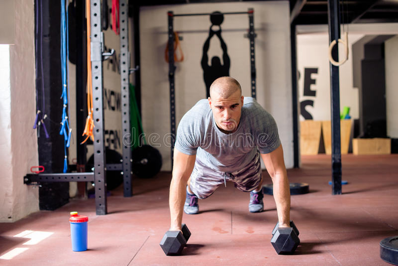 Man doing push-ups. In gym stock photography