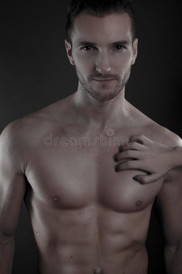 man with the hand of a woman posed on his torso royalty free stock photo