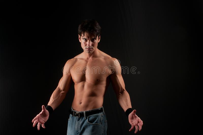 The man poses for the camera. And looks very hot royalty free stock photography