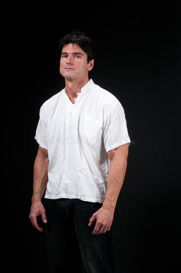 The man poses for a photograph royalty free stock photography