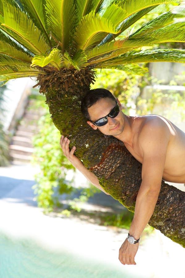 Man At Tropical Resort Stock Photo