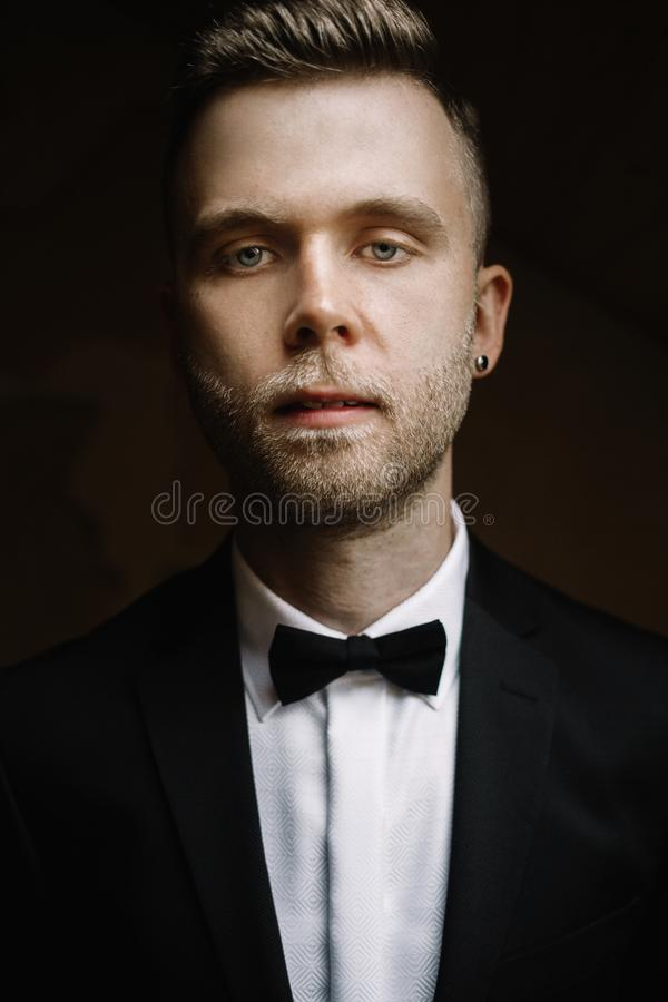 Close up portrait of young gentleman with raised eyebrow looking royalty free stock image