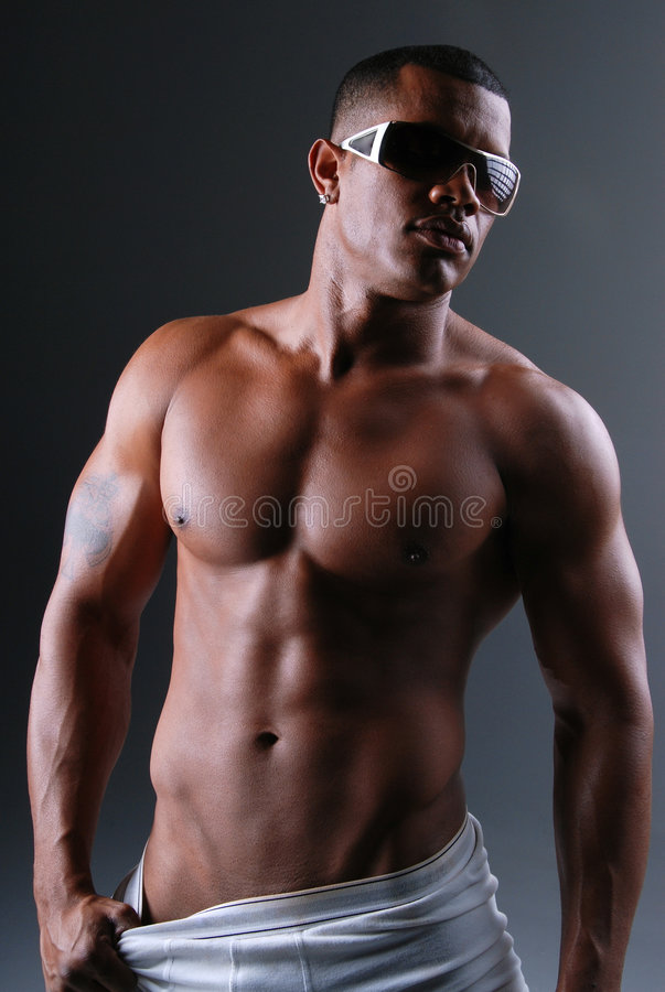 Man in underwear. Muscular African American man wearing white underwear and sunglasses