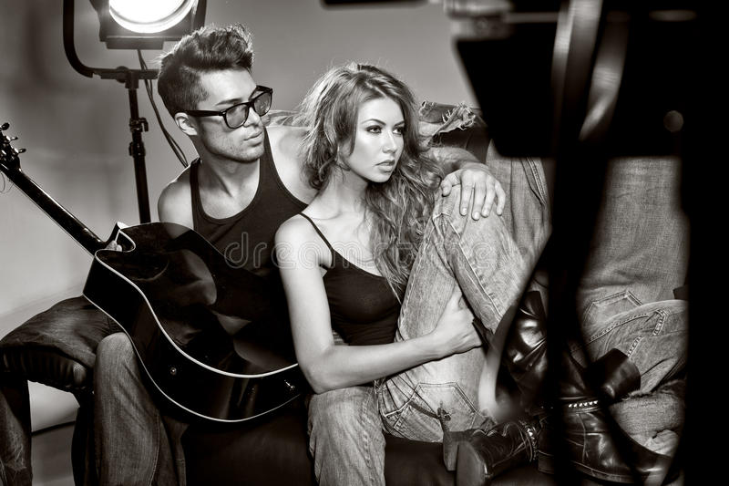man and woman doing a fashion photo shoot stock photos