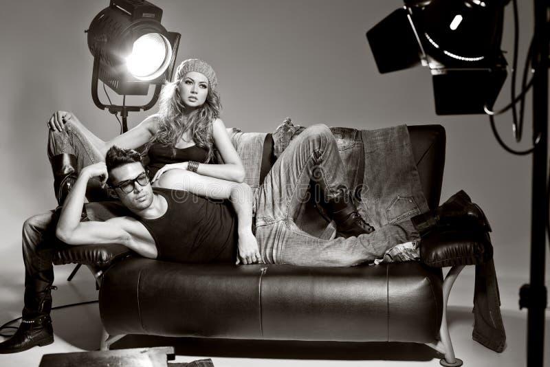 man and woman doing a fashion photo shoot royalty free stock photos
