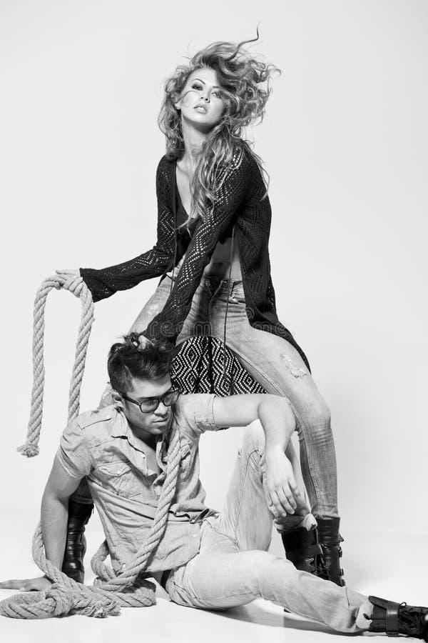 man and woman doing a fashion photo shoot stock image