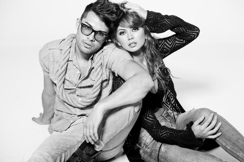 man and woman doing a fashion photo shoot stock images