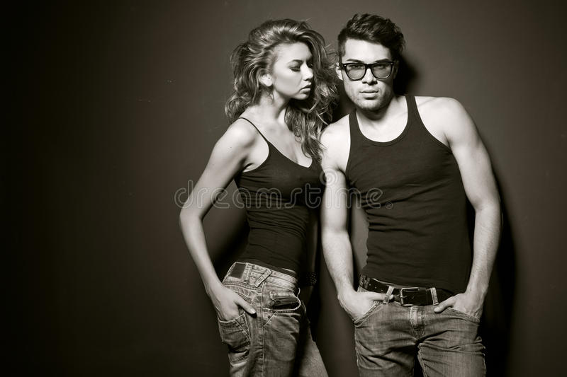 Man and woman doing a fashion photo shoot. Men and women doing a fashion photo shoot in a professional studio stock photography