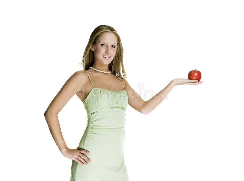 Sexy meisje met appel stock foto's