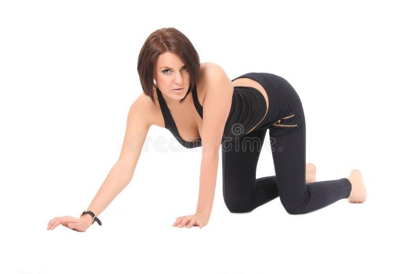Sexy meisje op haar knieën stock afbeelding
