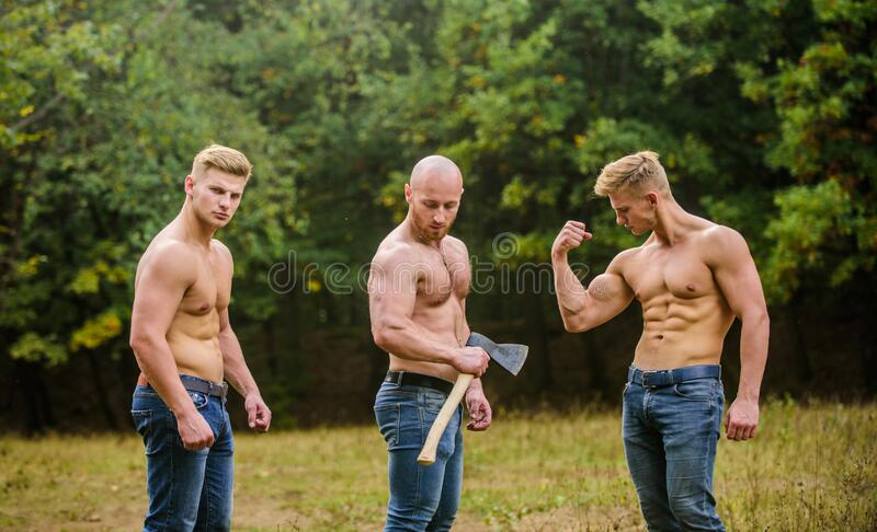 Sexy men with muscular torso. Brutal macho style. Strong men are sexy. showing abs. full of energy. Inspiring better. Health. three muscular men with axe royalty free stock photography