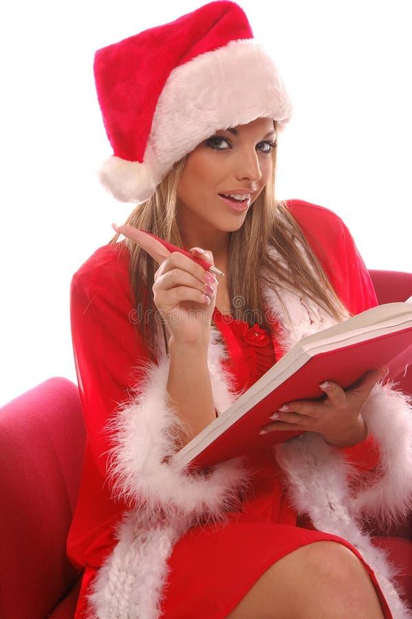 Sexy Mevr. Santa; s- Lijst stock afbeeldingen
