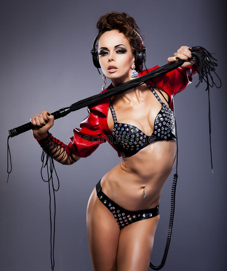 Download Mistress In Headphone And Whip In Erotic Pose Royalty Free Stock Images - Image: 27517299