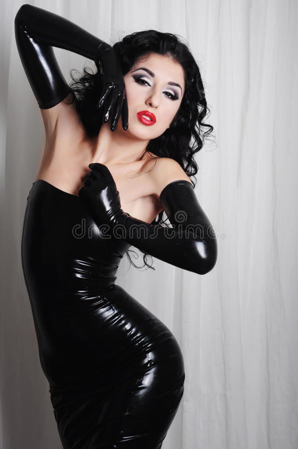 mistress wearing long black latex gloves stock images