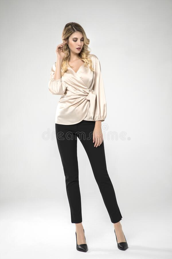 Free Sexy Model Posing In Silk Top And Black Pants. Royalty Free Stock Photos - 183201928
