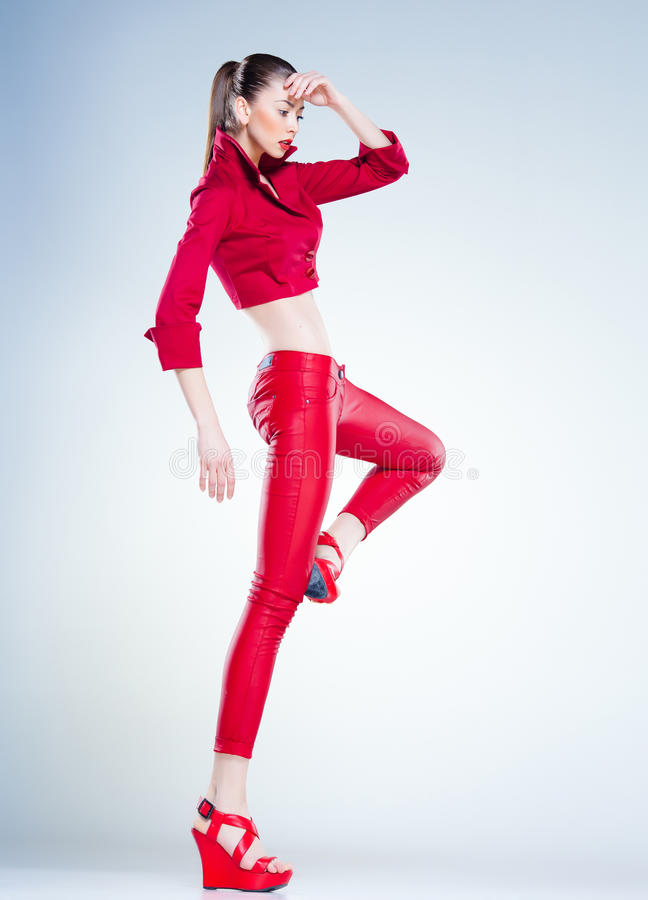 Download Model With Slim Body Dressed In Red Jumping In The Studio Stock Photo - Image of legs, beauty: 29564154