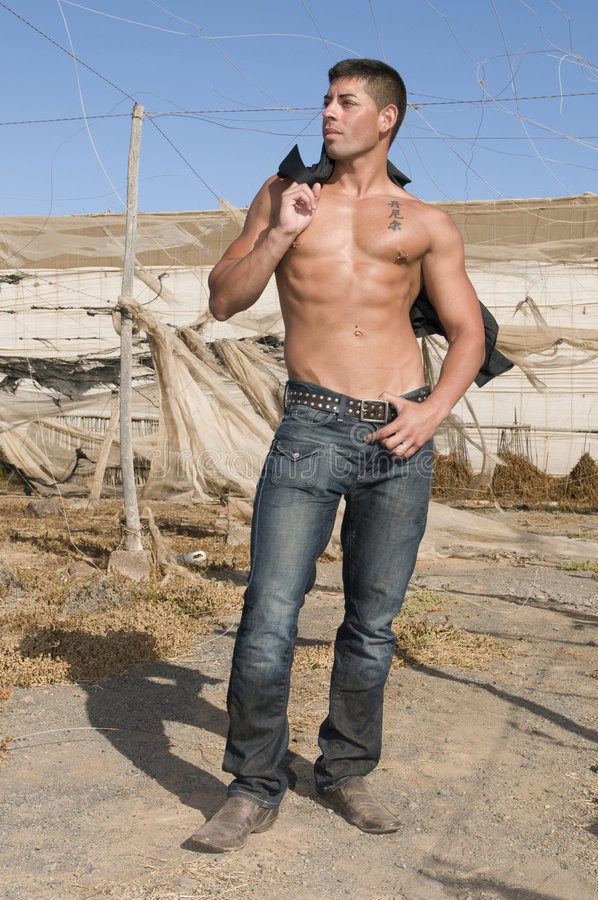 Download Muscled Man With Jeans In Desolated Place Stock Image - Image: 7077305