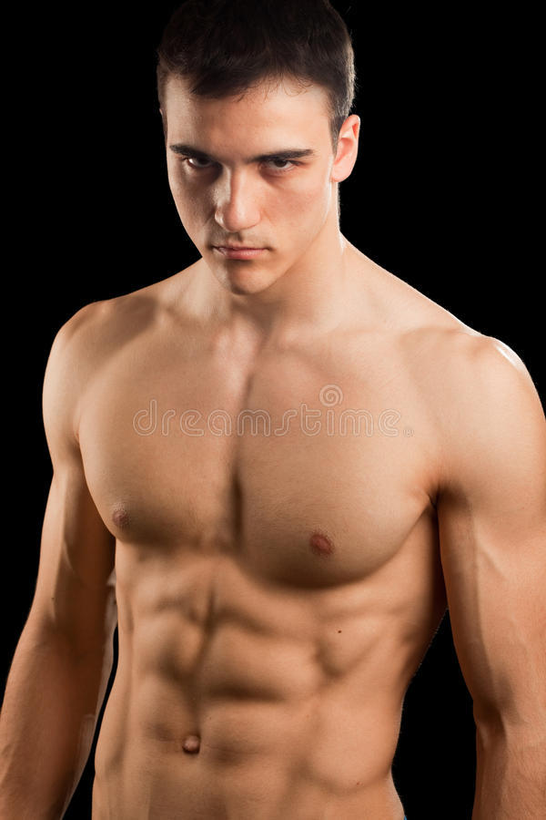 Muscular man. Isolated on black stock photography