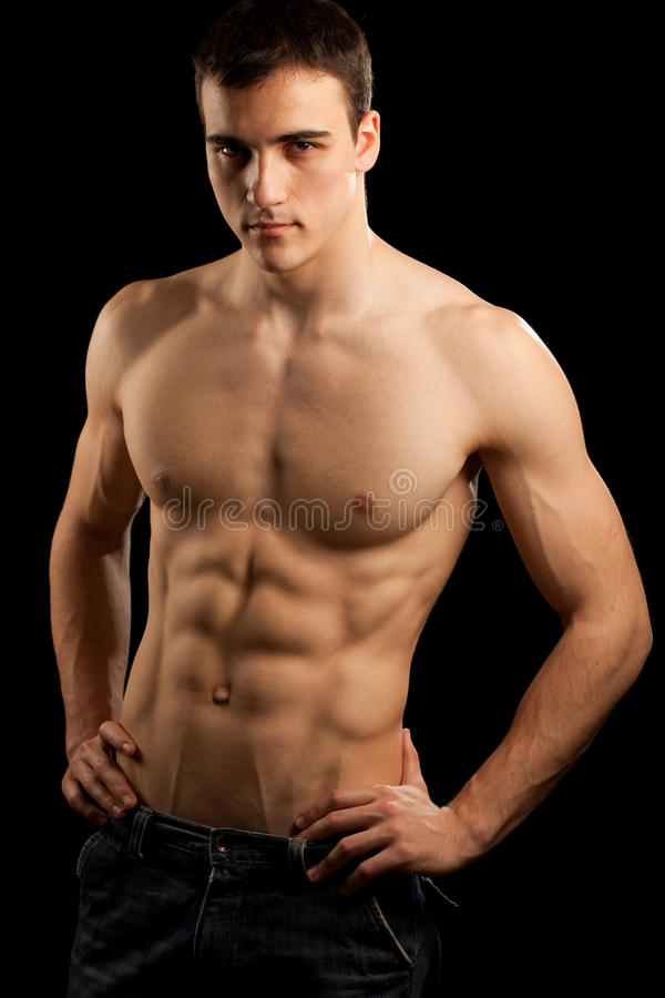 Muscular Man. Isolated on black stock photos