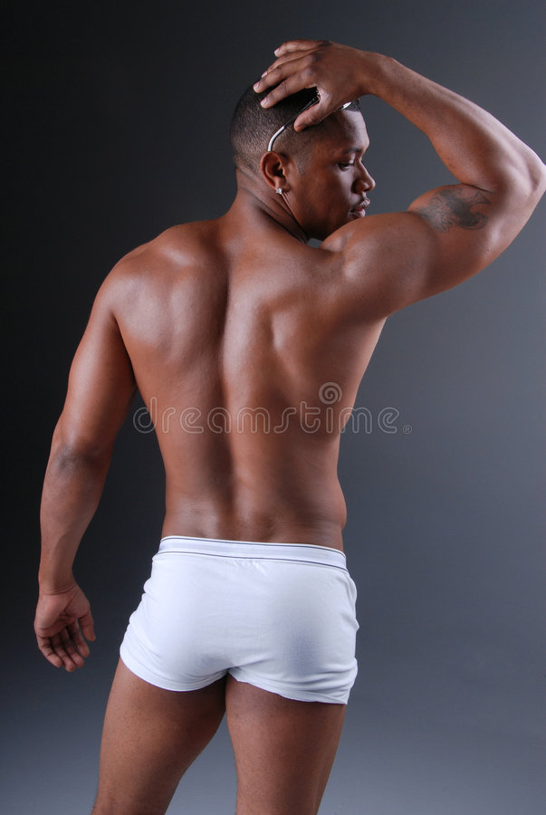 Muscular man. Back view of a muscular African American man royalty free stock photography