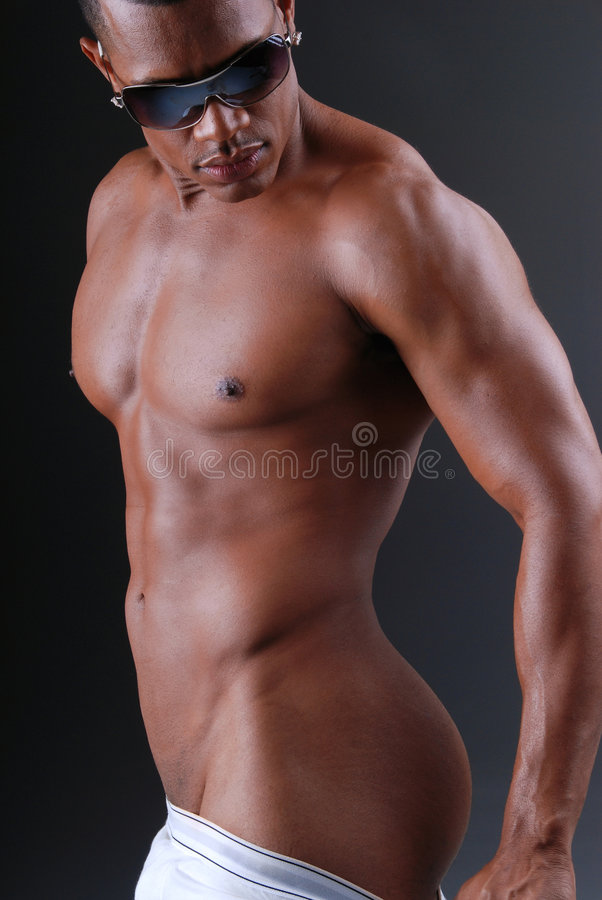 Muscular man. Muscular African American man pulling down the back of his underwear royalty free stock images
