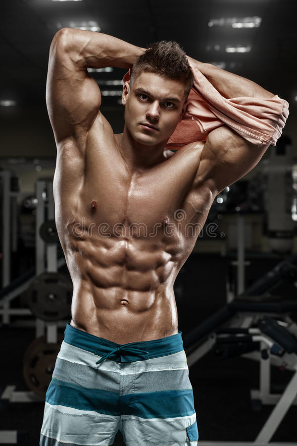 muscular man in gym, shaped abdominal. Strong male naked torso abs, working out royalty free stock photos