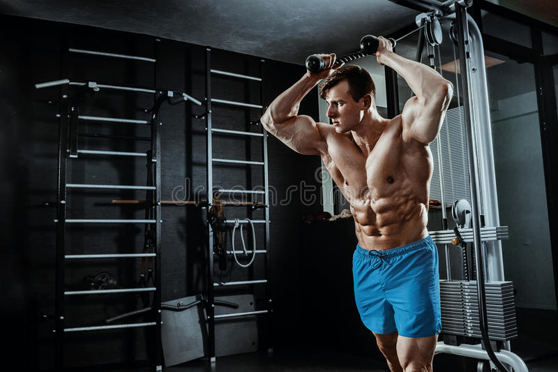 muscular man posing in gym, shaped abdominal. Strong male naked torso abs, working out stock photos