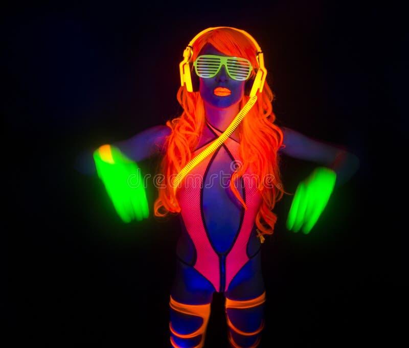 Sexy Neonuvglühentänzer lizenzfreies stockbild