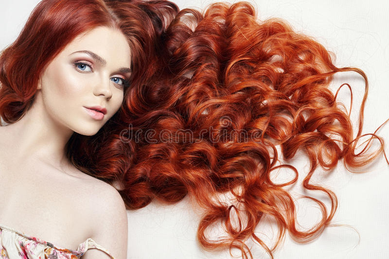 nude beautiful redhead girl with long hair. Perfect woman portrait on light background. Gorgeous hair and deep eyes. Natural royalty free stock photos