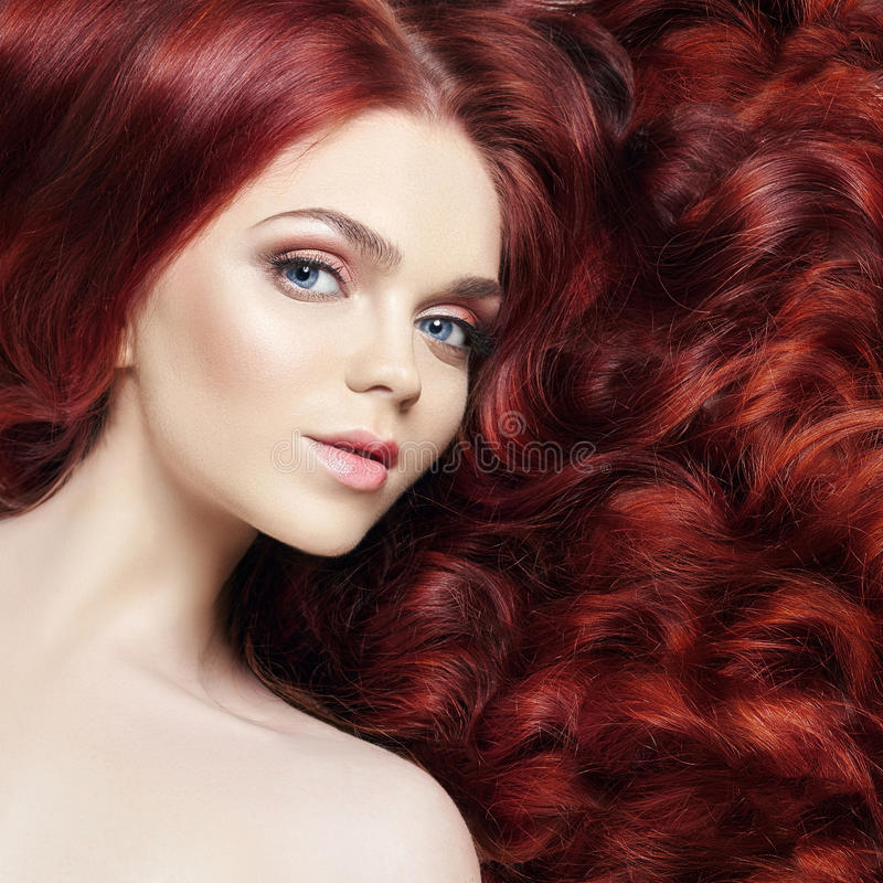 nude beautiful redhead girl with long hair. Perfect woman portrait on light background. Gorgeous hair and deep eyes. Natural royalty free stock images
